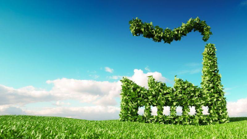 Symbild: Die Grafik zeigt eine nachhaltige Fabrik, die aus grünen Blättern besteht und auf einer grünen Wiese steht.