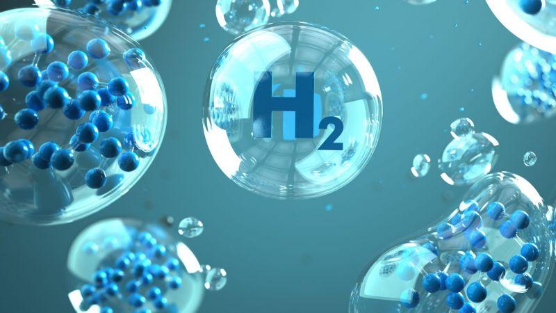 Das Symbolbild zeigt blaue Wasserstoff-Moleküle und -blasen, die das Gas darstellen.