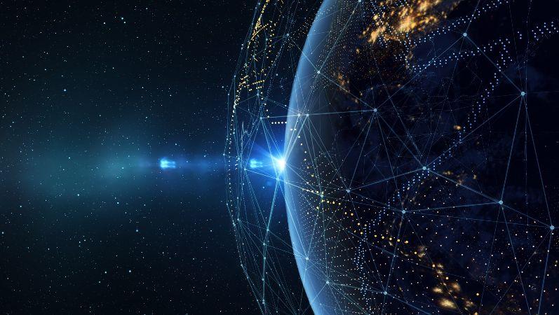 Symbolbild: Blick aus dem All auf einen Teil der Weltkugel in der Nacht. Ein Netz aus Linien und Punkte steht für globale Verbindungen.